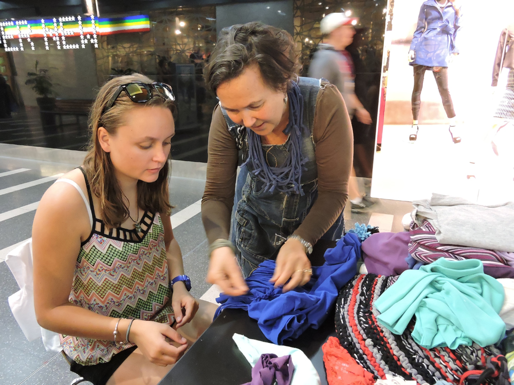 Jane Milburn (right) teaching Mikaela Moroney (left) to upcycle a t-shirt