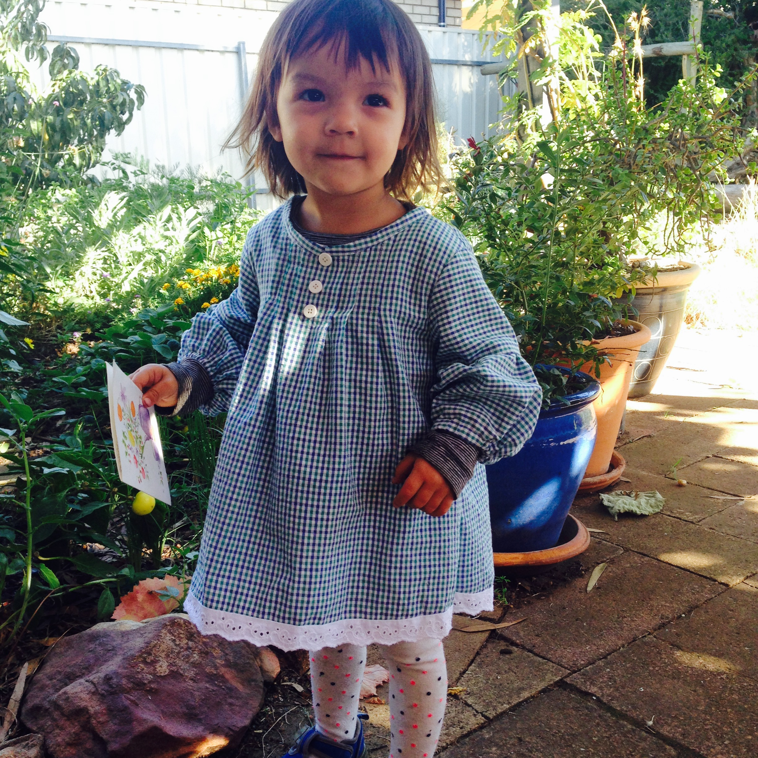 Gorgeous Flora Hanisch wears a dress handmade by her mum Xin