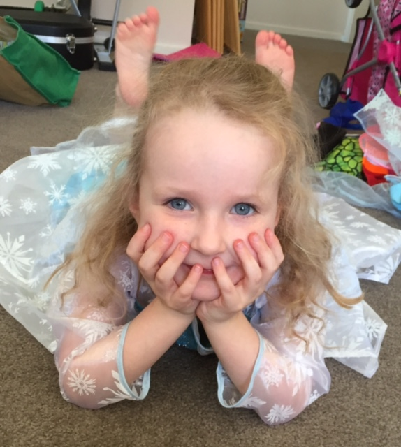 Chloe wearing the Frozen dress Sally made for her from a redeployed sparkly shirt