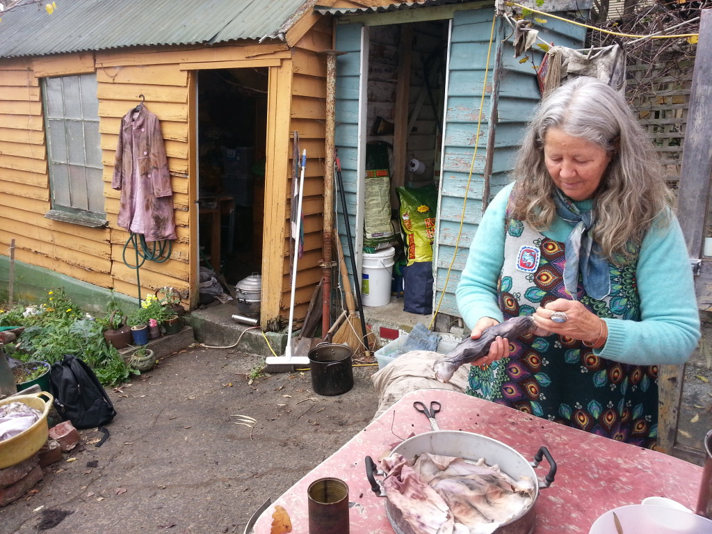 Kate Fletcher in her backyard using dyeing as one of her making techniques