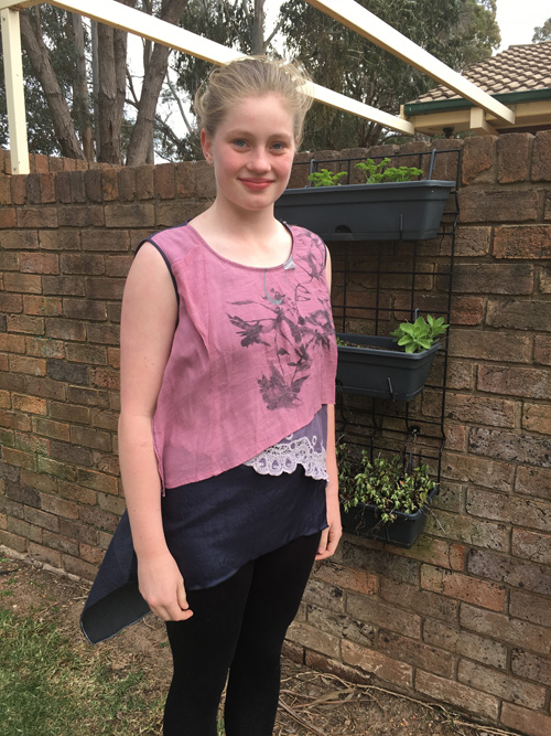 Grace wears tunic upcycled by her mum Michelle